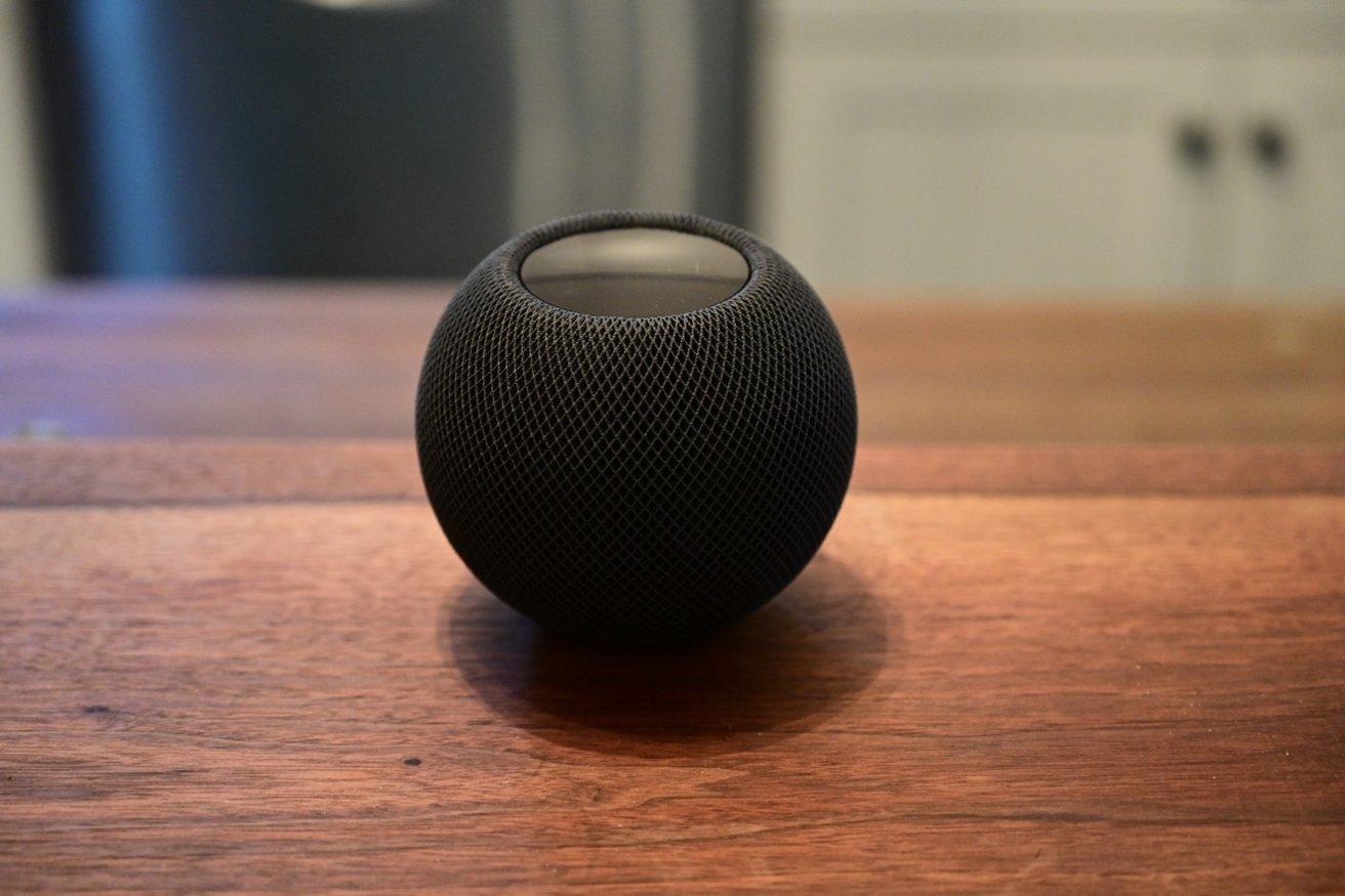 The HomePod mini retains a display, despite its small size.