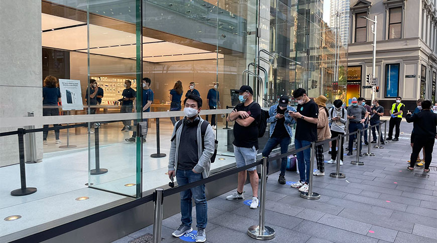 photo of Customers line up for iPhone 12 as pre-orders arrive image