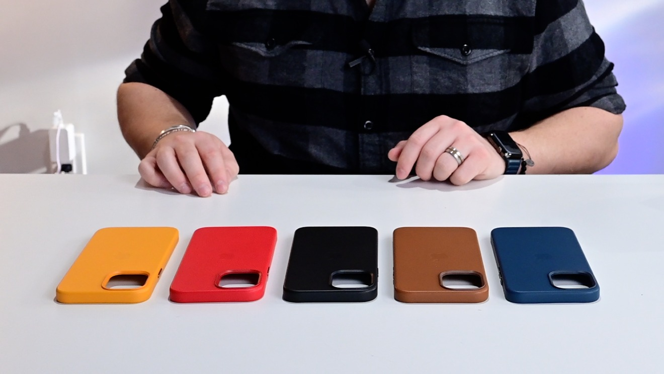 Apple's leather case colors from left to right: California Poppy, (PRODUCT)RED, Black, Saddle Brown, Baltic Blue