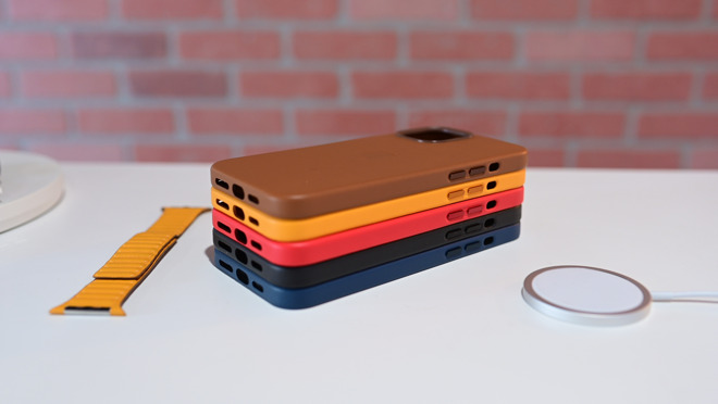 Apple's leather case covers the bottom of the phone and has anodized aluminum buttons