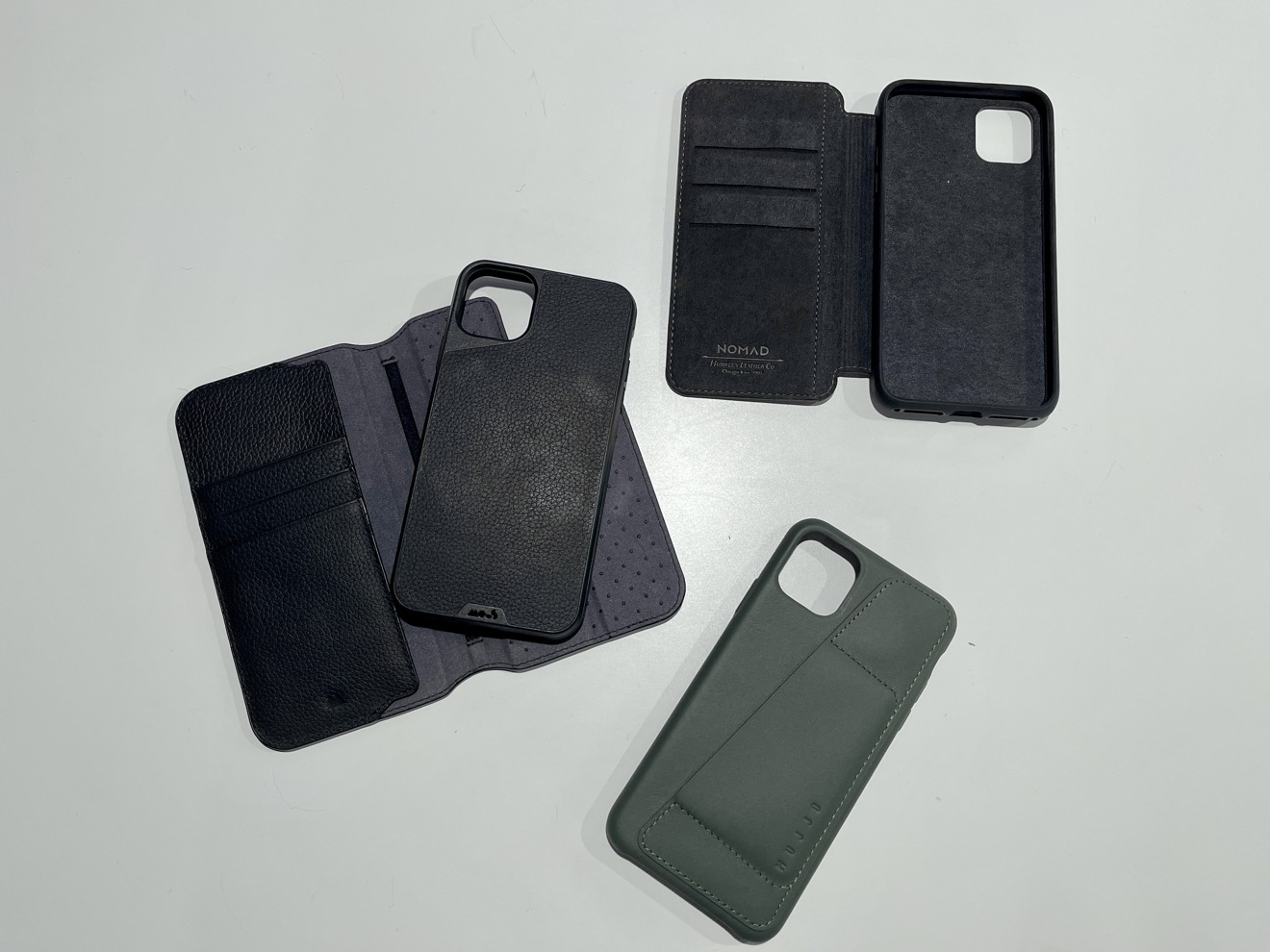 Just some of the wallets I've tried for the iPhone 11 Pro Max alone
