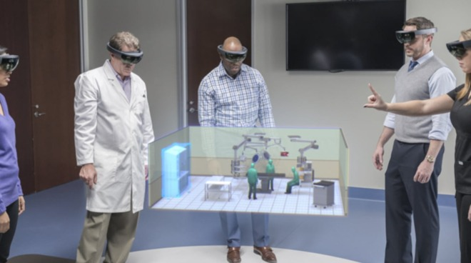 Microsoft's HoloLens, which can track fingers for input to control AR content.
