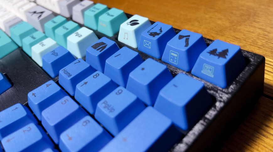 Dark blue key caps with black characters can be hard to read in low light