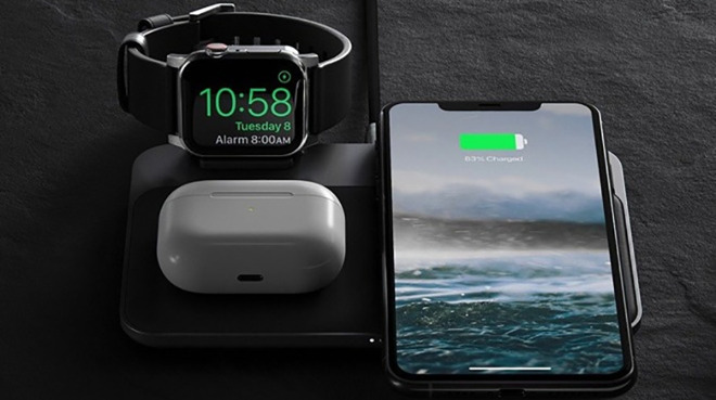 A charging station by Nomad used to recharge an iPhone, Apple Watch, and AirPods Wireless Charging Case simultaneously.