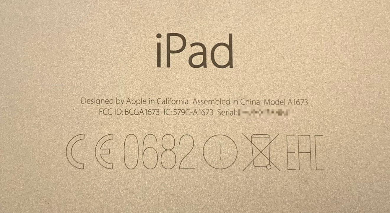 You can find your iPad serial number on the back alongside regulatory information.