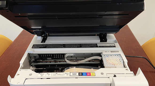 Filling the ink tank and fixing paper jams can be done by lifting the scanner bed