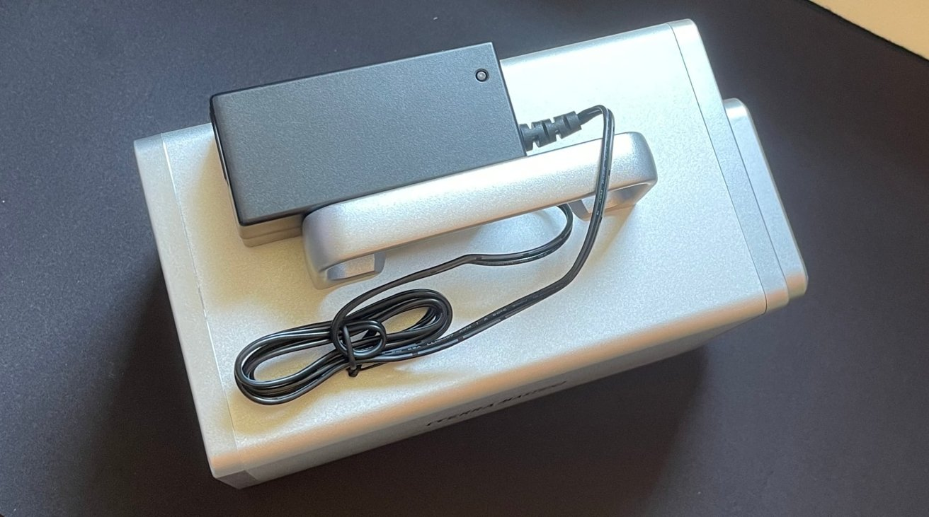 The power brick is hefty for both units, but separating it keeps the size of the enclosures down.