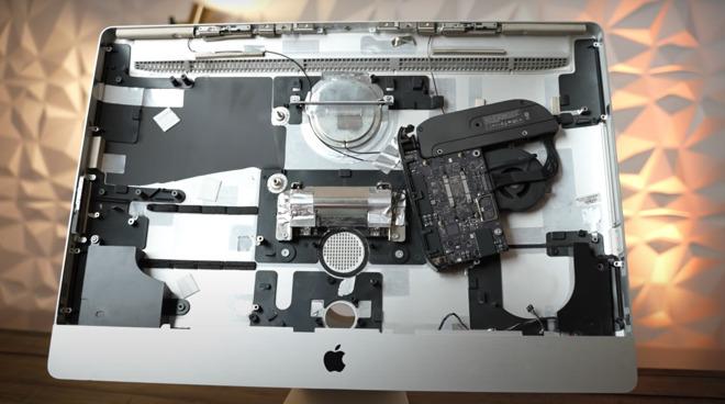 The Mac mini is held in via one screw inside the iMac