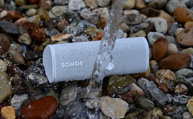 A stream of water hitting the Sonos Roam