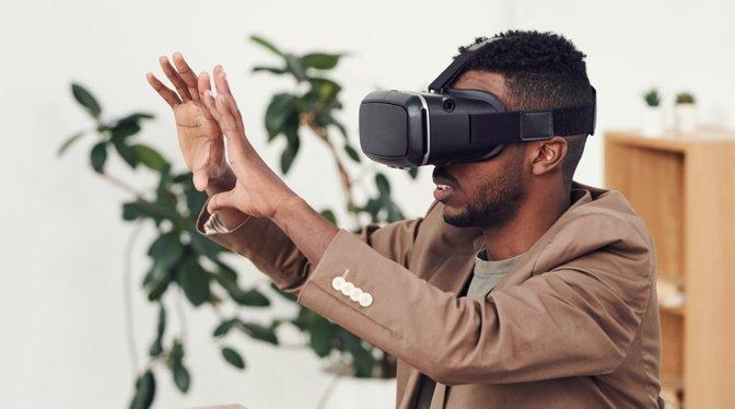 A man wearing a VR headset. [via Fauxels/Pexels]