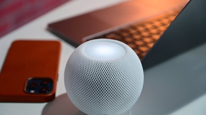 The HomePod mini is covered with fabric, though not fabric buttons.