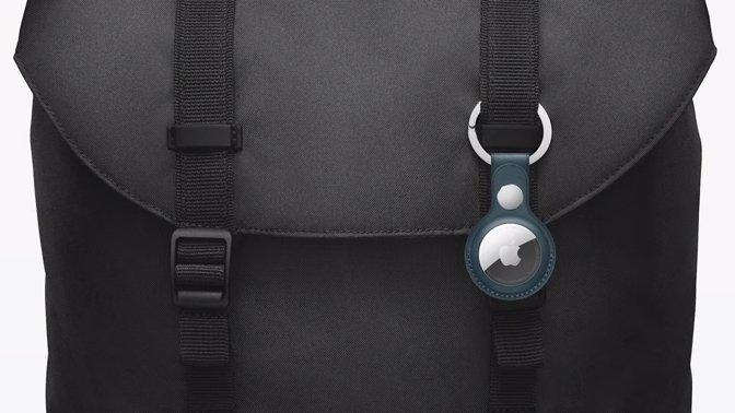 An Apple AirTag clipped to a bag