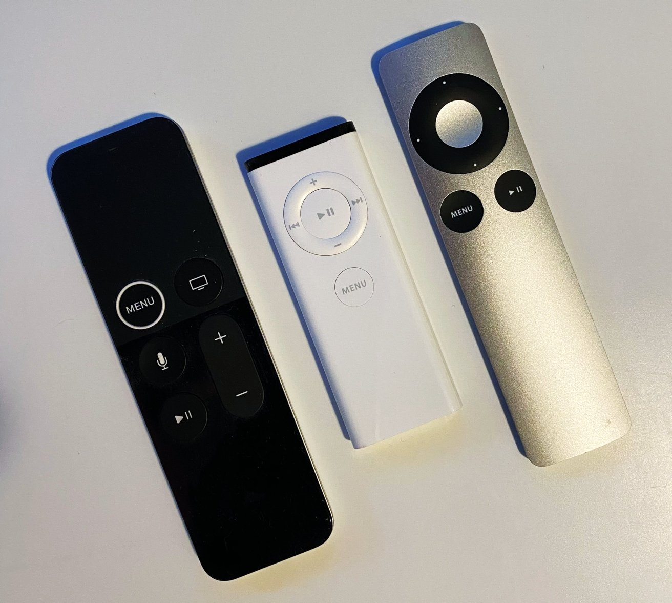 The refreshed first-generation Siri Remote (left), the first Apple Remote (middle), the second Apple Remote (right)