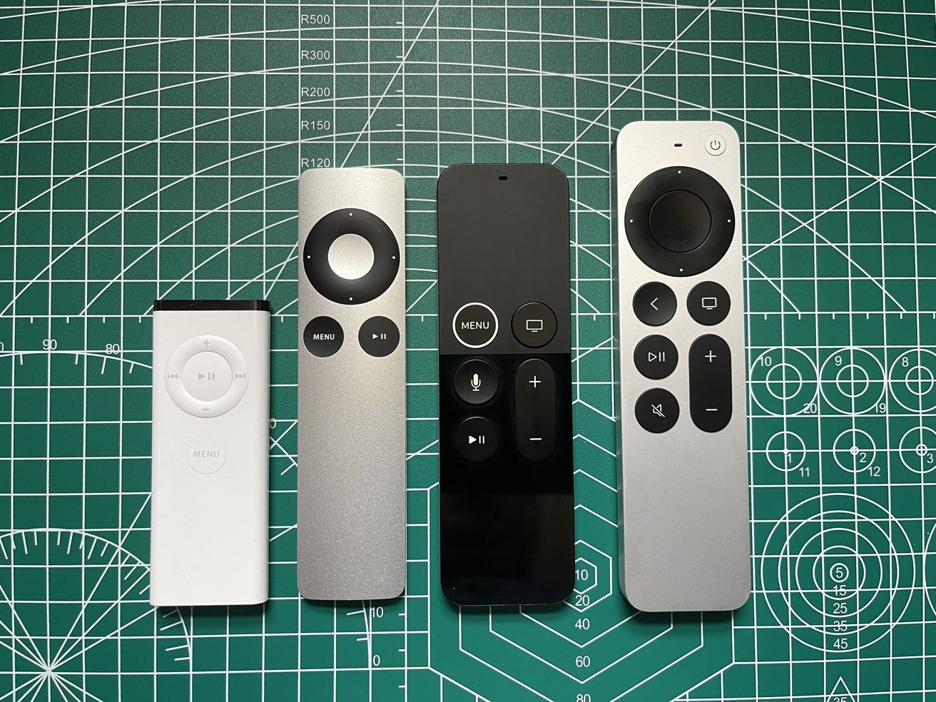 The first Apple Remote (First from the left), the second Apple Remote, the refreshed first-generation Siri Remote, the second-generation Siri Remote.)