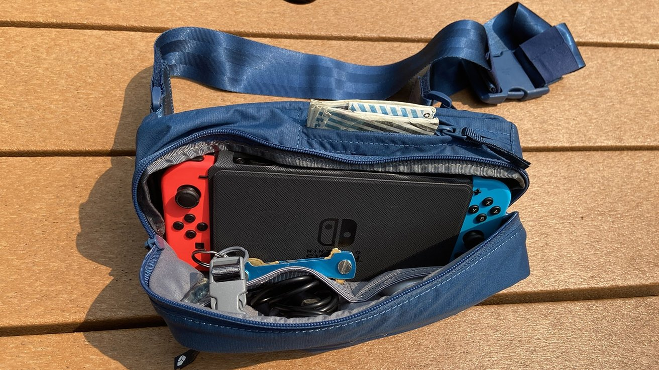 The hipsack is large enough to hold a Nintendo Switch