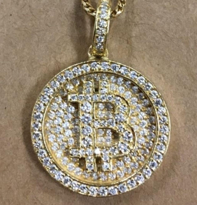 Laws' diamond-encrusted Bitcoin medallion | Source: U.S. Attorney's Office