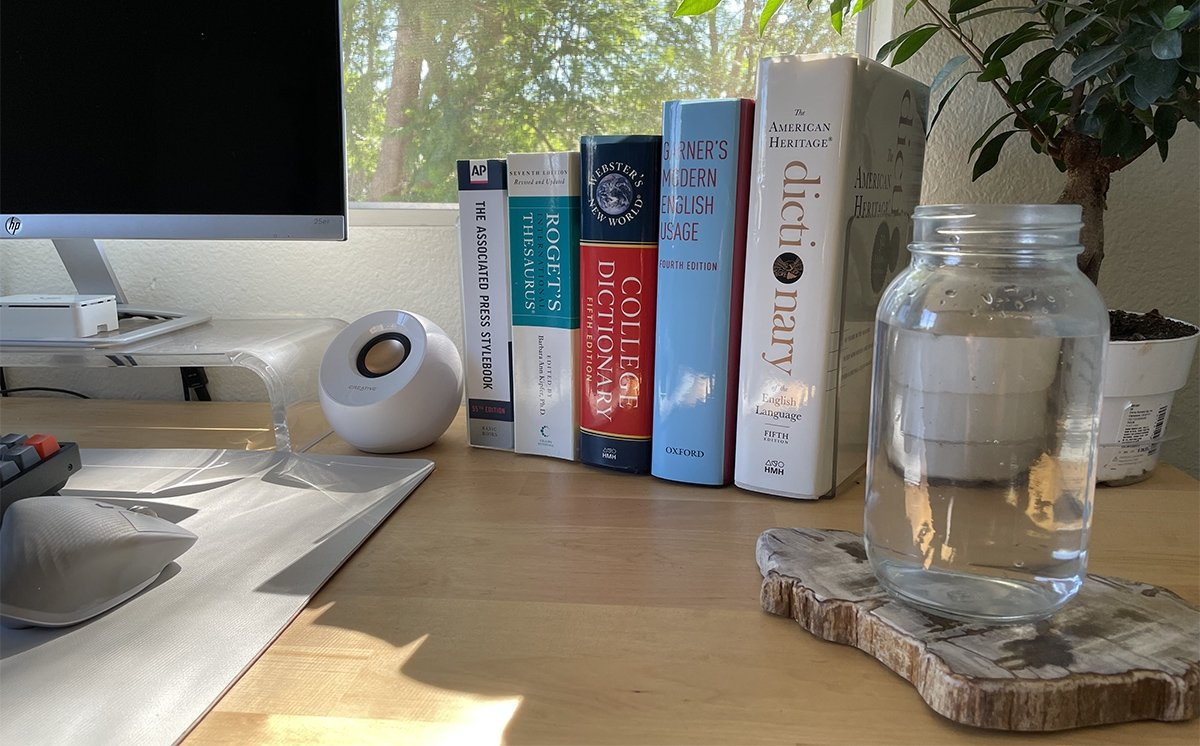 A few physical reference books and a 32oz Mason jar are some must-haves for Mike Peterson.