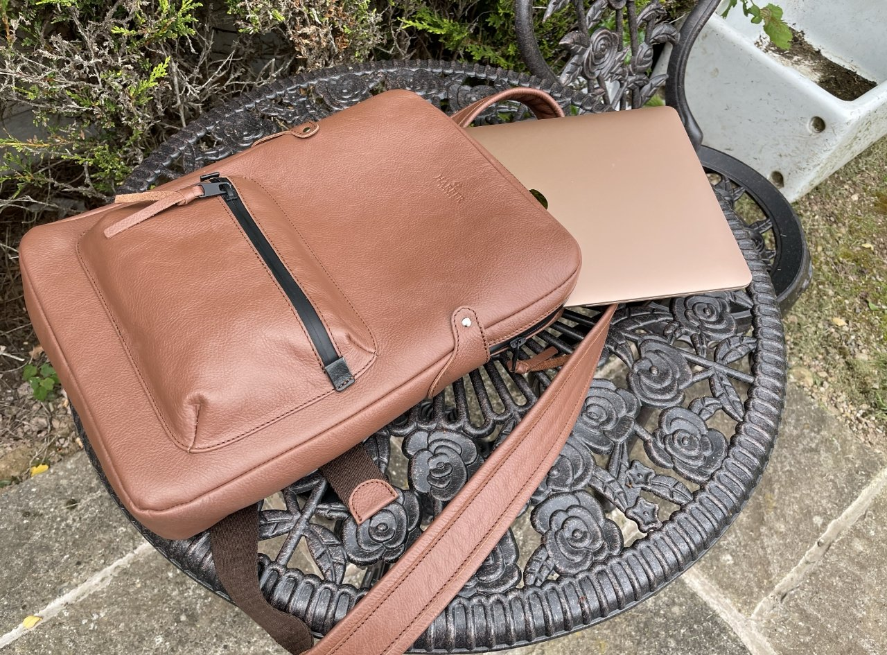 This medium size backpack neatly holds a 13-inch MacBook Air (pictured) or MacBook Pro