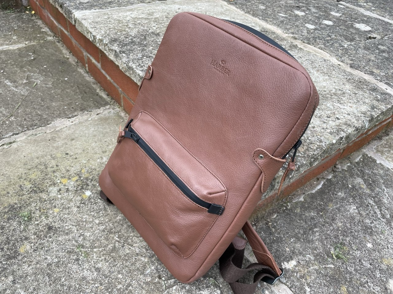 The exterior is fine grain leather with aviation-grade aluminium buckles