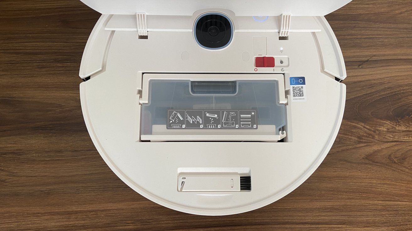 The top of the vacuum lifts up, providing access to the dustbin