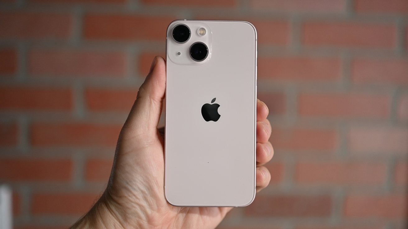 Holding the iPhone 13 mini