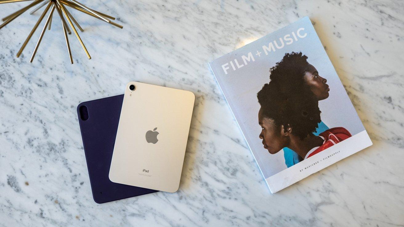 iPad mini in Starlight on table with magazine