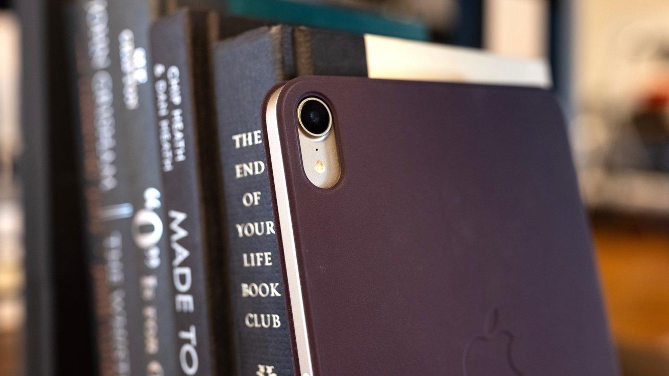 Close-up of an iPad mini camera on a bookshelf