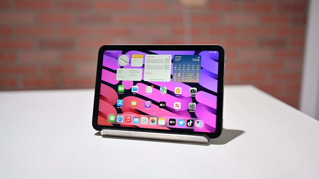 iPad mini with purple background on the stand